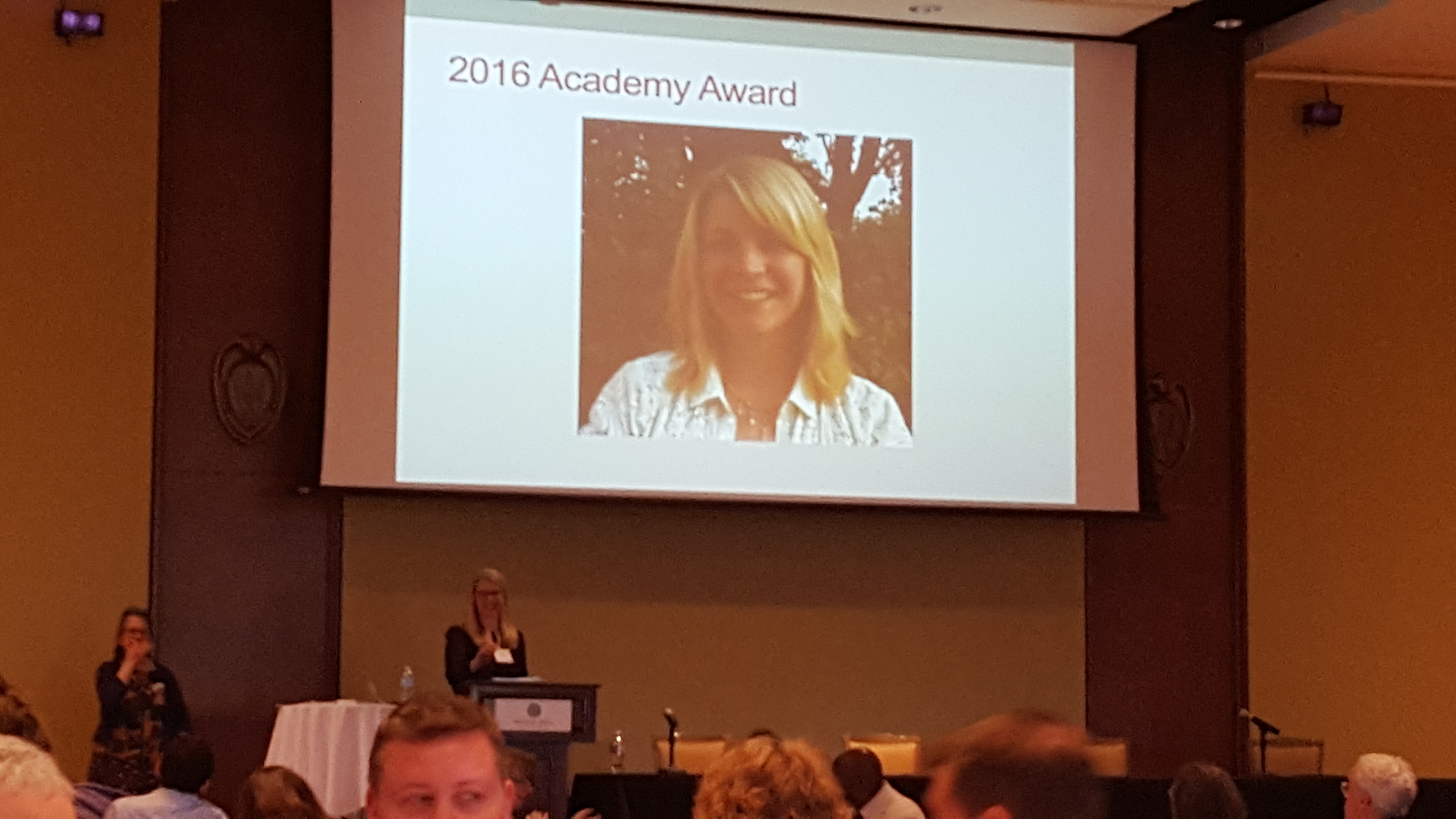 Sarah Miller accepts the Distinguished Fellow award from the Teaching Academy during lunch