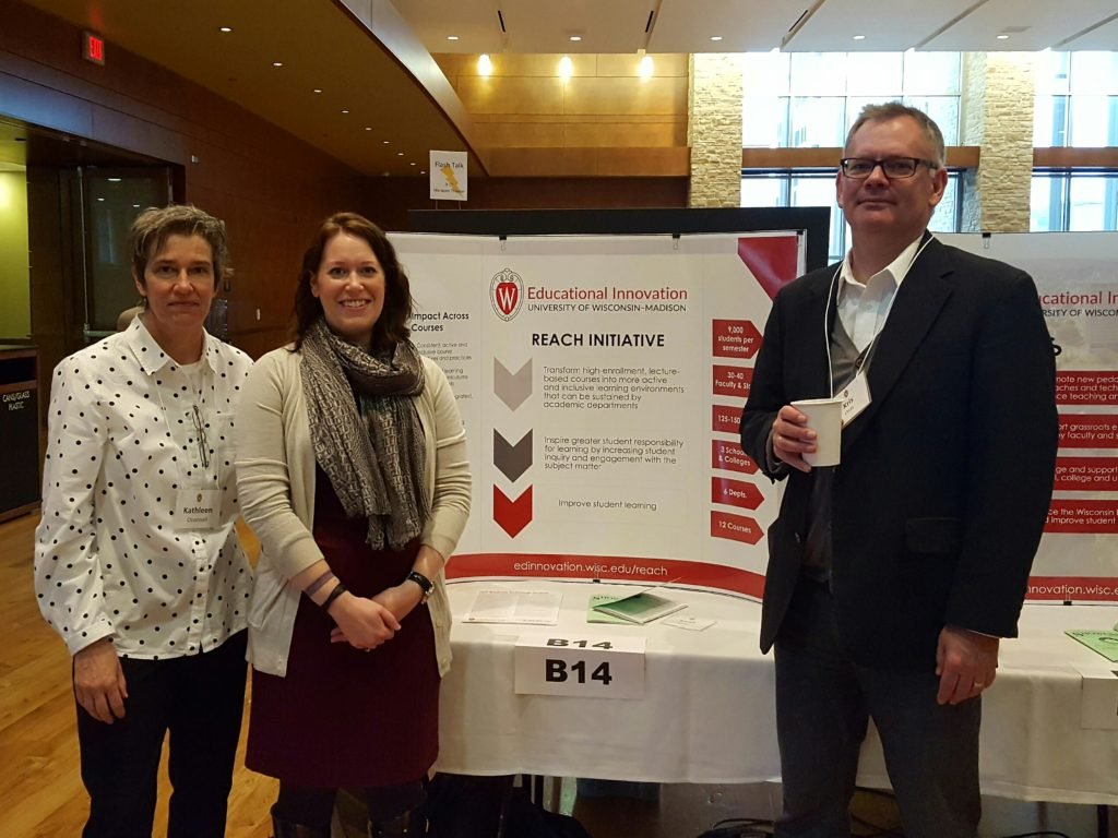 Kathleen O'Connell, Theresa Pesavento and Kris Olds at the REACH poster.